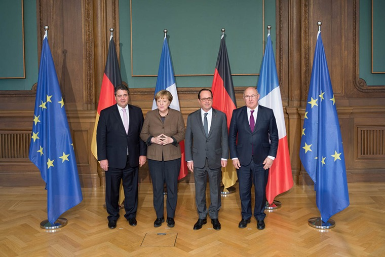 Federal Minister for Economic Affairs Sigmar Gabriel, Federal Chancellor Merkel, President Hollande and  Michel Sapin, Minister of the Economy, Industry and Digital Affairs