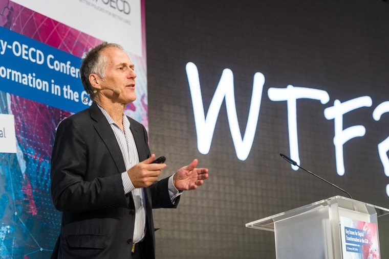 Tim O'Reilly, founder and CEO of O'Reilly Media Inc., gave a presentation outlining the benefits and the challenges linked to digitalisation; source: BMWi/Maurice Weiss
