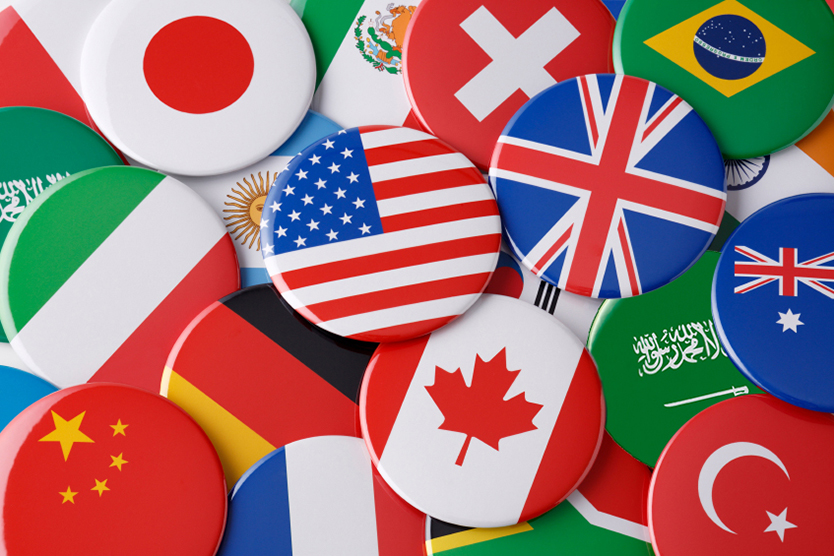 Buttons with different flags symbolize the World Economic Summit; Source: istockphoto.com/studiocasper